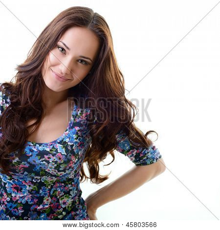 Beautiful young woman with beauty long brown hair posing at studio, face closeup over white