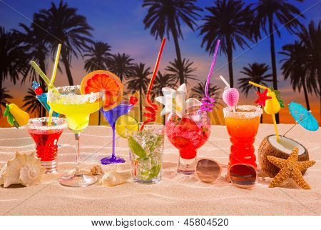 beach tropical cocktails on white sand mojito blue hawaii on sunset palm trees