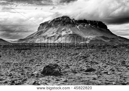 "Herdubreid is one of the most beautiful Icelandic volcanoes, the ""Queen of Icelandic mountains"" . It is almost symmetric, with a icecap, hidden in the highlands. Black and white poster"