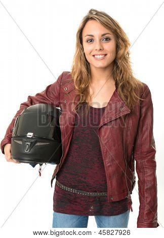 Young female biker holding a crash helmet