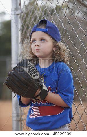 Girl with baseball mitt on sideline