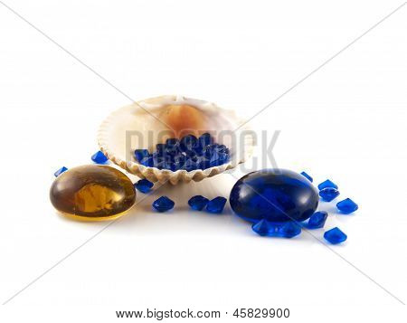 Shell on white background with blue crystals