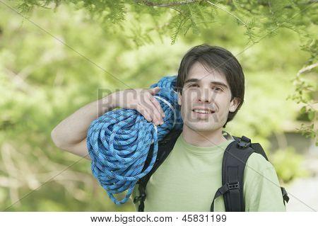 Man holding a bundle of climbing rope