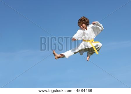 fit child or kid doing martial arts karate kick midair poster