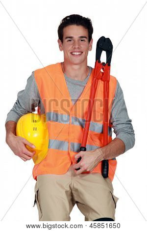 Worker in a reflective vest with helmet and boltcutters