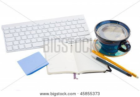 open note pad  on working table on white