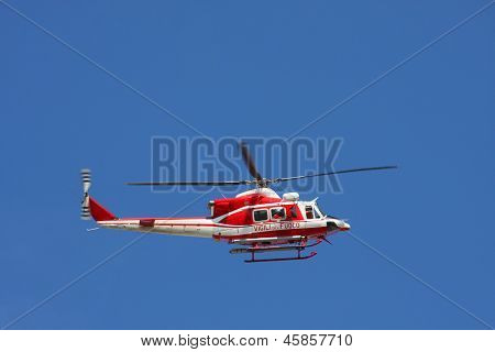 Patrol Helicopter Of Firefighters In Blue Sky Over A Fire 3