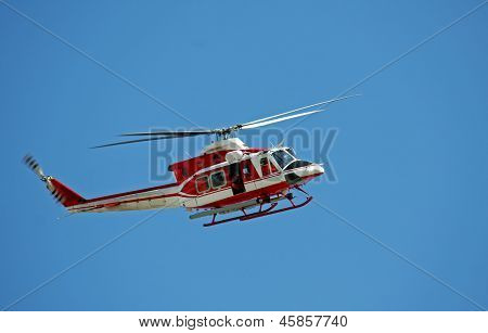 Patrol Helicopter Of Firefighters In Blue Sky Over A Fire 10