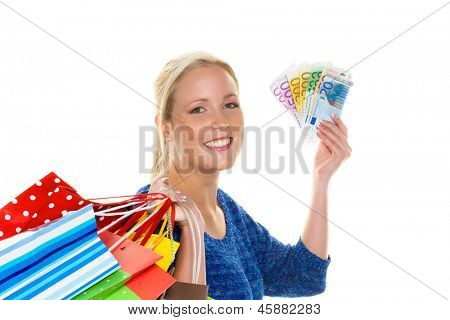 a young woman with colorful shopping bags while shopping. with euro banknotes money poster