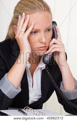a frustrated woman phoned the office. stress and strain in the workplace. poster