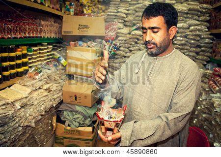 Incense Man Burning Myrrh On Market, Suk, In Muscat, Oman