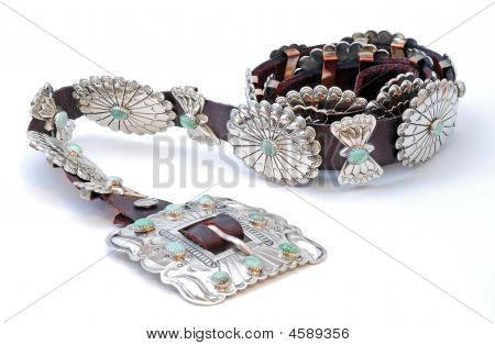 Beautifully handcrafted Native American silver and turquoise concho belt isolated on white. poster