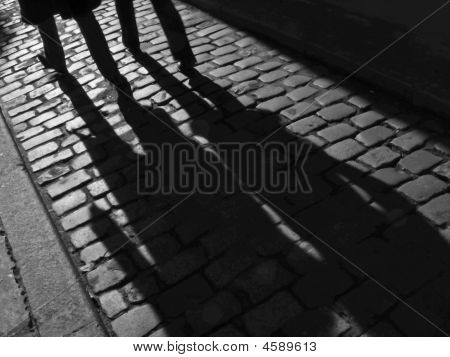 Furtive Shadows of A Couple In The Street.