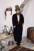 Dervish in kitchen of Mevlana monastery Afyon Turkey poster