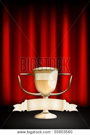 Award trophy cup and red curtain