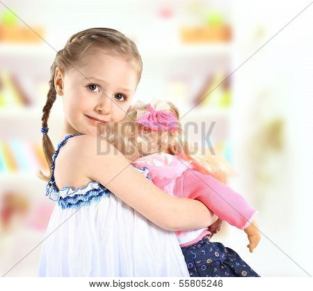 cute little girl with a doll