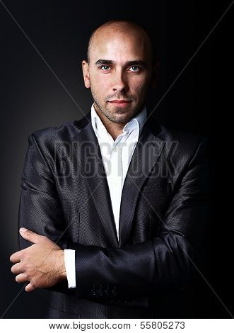 Cool businessman standing on dark gradient background