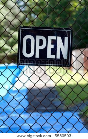 Open sign on the fence