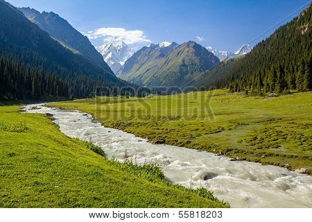 Mountain ridge and rapid river. Tien Shan, Kirgizstan poster