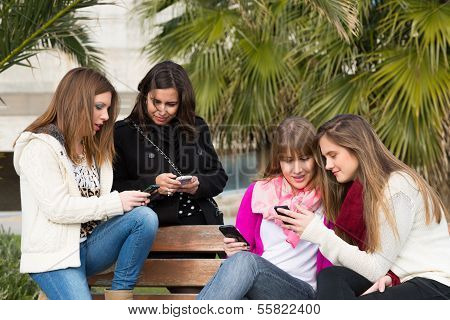 Girls gathered at the university to send mobile messages poster