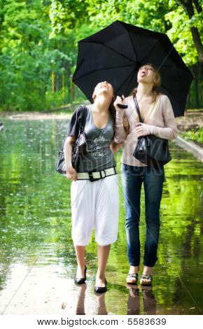 Two Girls Rejoice To Rainy Weather