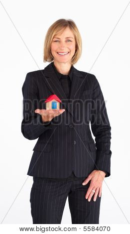 Businesswoman Presenting A Model Of House