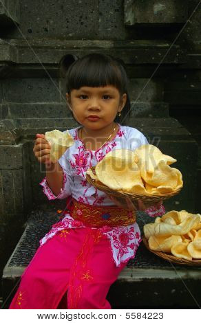Girl Holding Prawn Crackers