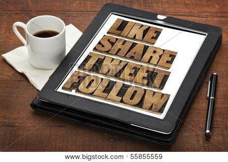 like, share, tweet, follow words - social media concept - isolated text in vintage letterpress wood type on a digital tablet with cup of coffee