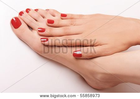 Relaxing red manicure and pedicure