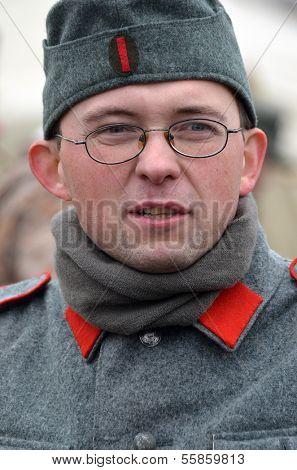 KIEV, UKRAINE -NOV 2:An unidentified member of Red Star history club wears historical Belarussian collaborationist Police uniform during historical reenactment of WWII, November 2, 2013.Kiev, Ukraine