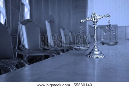 Symbol of law and justice in the empty courtroom BLUE TONE poster