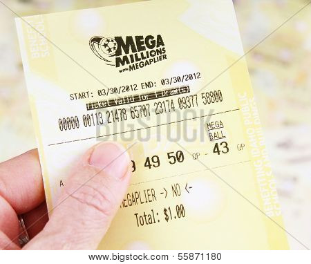 BOISE, IDAHO - DECEMBER 21, 2013: A woman's hand holding a Mega Millions lottery ticket on December 21, 2013 in Bosie, Idaho.