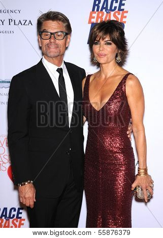 LOS ANGELES - MAY 03:  Harry Hamlin & Lisa Rinna arrives to the Race To Erase MS 2013  on May 03, 2013 in Century City, CA