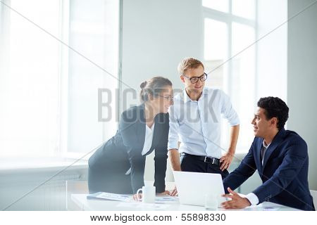 Portrait of smart business partners planning work at meeting