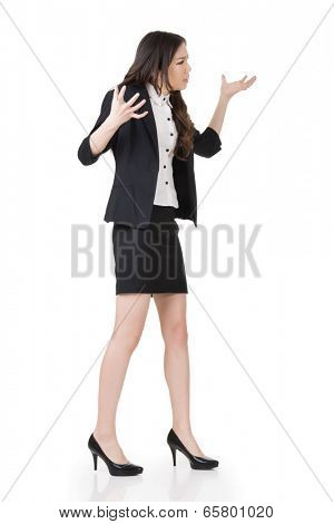 Angry businesswoman of Asian, full length portrait isolated on white.