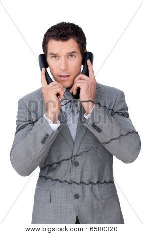Stressed Businessman Tangle Up In Telephone Wires