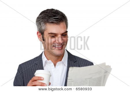 Charismatic Businessman Drinking A Coffee While Reading A Newspaper