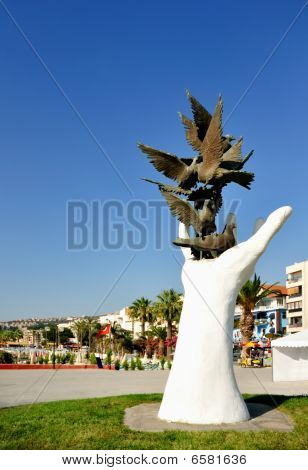 This photograph represent the visit card of Kusadasi City (Turkey) - Sculpture hand of peace. The town's name meaning 'Bird Island' is taken from the island was a much-frequented resting place of birds during seasonal migrations. Kusadasi h poster