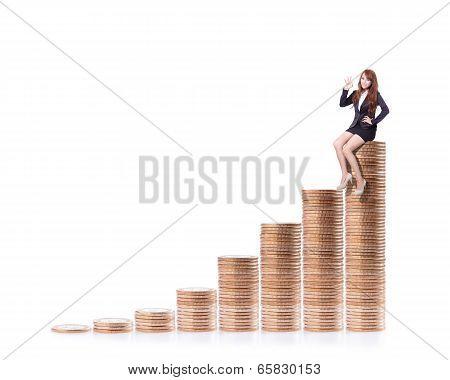 Success Business Woman Sitting On Money