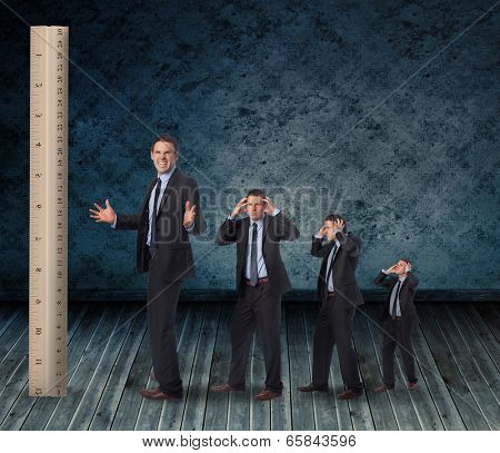 Composite image of multiple image of angry businessman with ruler against dark grimy room