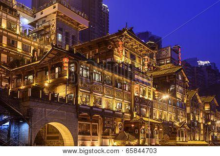 Chongqing, China at Hongyadong hillside buildings.