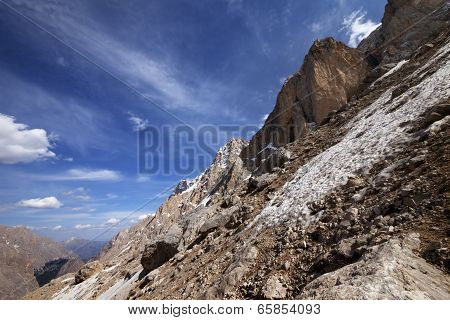 Rocks With Snow At Sun Day