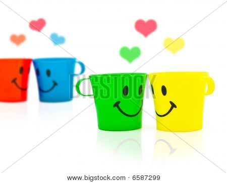 Multi-coloured Bright Cups With Drawing In A Kind Of Smile