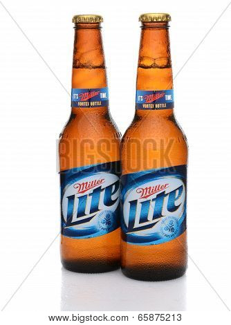 Two Miller Lite Bottles With Condensation