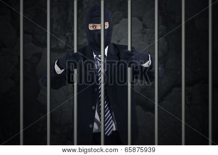 Businessman Wearing A Mask In Jail