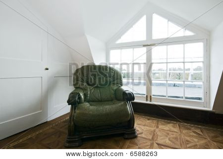 Detail Shot Of A Living Room With A Roof Window And Green Vintage Leather Armchair