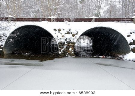 Snow covered storm water drainage tunnel.