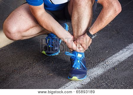 Broken Twisted Ankle - Running Sport Injury. Male Runner Touching Foot In Pain Due To Sprained Ankle
