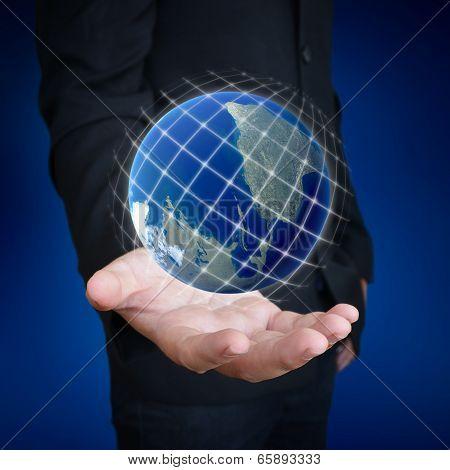 human hand holding earth