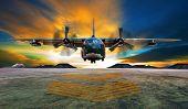 military plane landing on airforce runways against beautiful dusky sky poster
